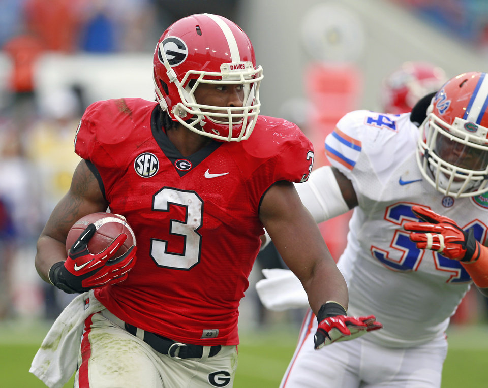 Photo -   CORRECTS CITY TO JACKSONVILLE, NOT GAINESVILLE - Georgia running back Todd Gurley (3) gets around Florida linebacker Lerentee McCray for yardage during the first half of an NCAA college football game, Saturday, Oct. 27, 2012, in Jacksonville, Fla. (AP Photo/John Raoux)