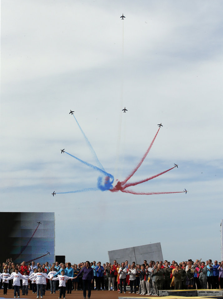 Photo - The Patrouille de France aerobatic team performs during the D-Day commemoration at the Ouistreham beach, western France, Friday, June 6, 2014. World leaders and veterans gathered by the beaches of Normandy on Friday to mark the 70th anniversary of World War Two's D-Day landings. (AP Photo/Christophe Ena, Pool)