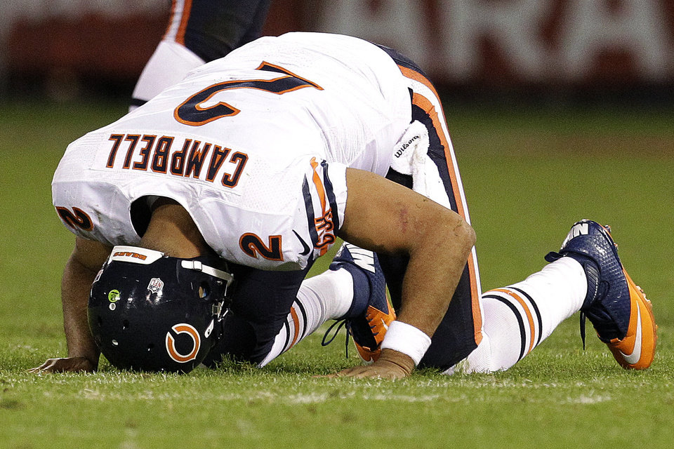 Photo -   Chicago Bears quarterback Jason Campbell (2) gets off the ground after being tackled during the second half of an NFL football game against the San Francisco 49ers in San Francisco, Monday, Nov. 19, 2012. (AP Photo/Tony Avelar)
