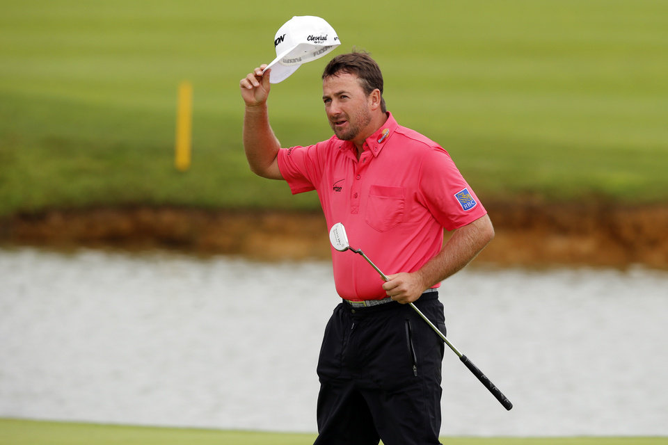Photo - Graeme McDowell of Northern Ireland waves to the public on the 18th green to win the French Open Golf tournament at Paris National course in Guyancourt, west of Paris, France, Sunday, July 6, 2014. (AP Photo/Francois Mori)