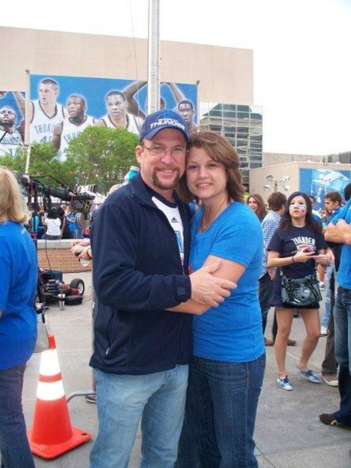 Altus cotton farmer Danny Robbins and wife Zina enjoy Thunder alley festivities before a recent game at the Chesapeake Energy Arena. <strong>provided</strong>