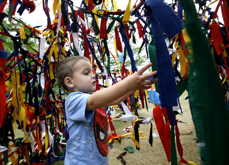 Kasen Price, 2, of Edmond, plays Sunday in the Festival of the Arts� children�s sculpture area.