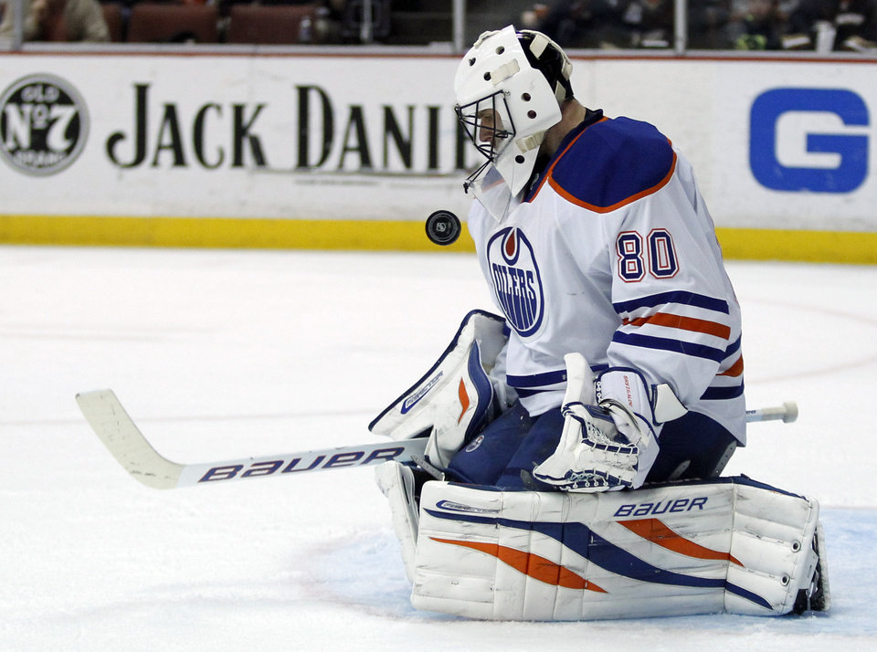 Photo - Edmonton Oilers goalie Ilya Bryzgalov, of Russia, stops a shot by the Anaheim Ducks during the second period of an NHL hockey game Friday, Jan. 3, 2014, in Los Angeles. (AP Photo/Alex Gallardo)