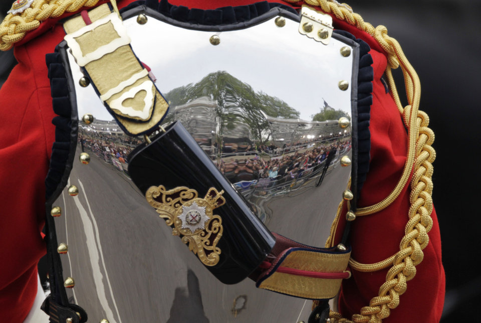 Photo - Media is reflected in the body armour of a member of the Household Cavalry outside Westminster Abbey at the Royal Wedding in London Friday, April 29, 2011. (AP Photo/Gero Breloer)  ORG XMIT: RWFO139