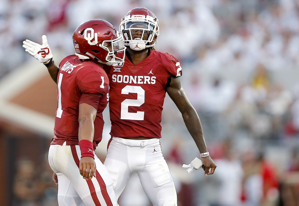 Photo - Oklahoma's CeeDee Lamb (2) and Jalen Hurts celebrate a Lamb touchdown in the second quarter during a college football game between the University of Oklahoma Sooners (OU) and the Houston Cougars at Gaylord Family-Oklahoma Memorial Stadium in Norman, Okla., Sunday, Sept. 1, 2019. [Sarah Phipps/The Oklahoman]