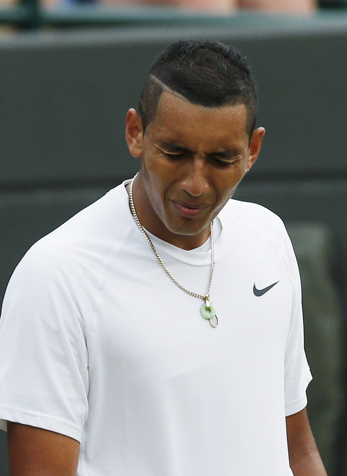 Photo - Nick Kyrgios of Australia reacts after losing a point during the men's singles quarterfinal match against Milos Raonic of Canada at the All England Lawn Tennis Championships in Wimbledon, London, Wednesday, July 2, 2014. (AP Photo/Ben Curtis)