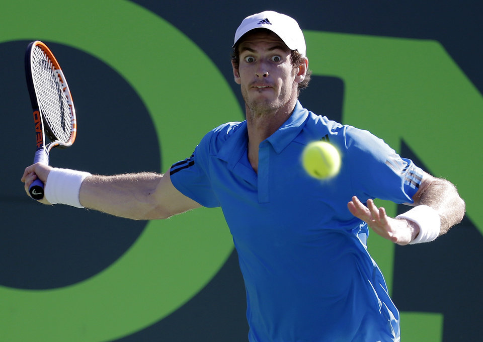 Photo - Andy Murray, of Great Britain, returns to Jo-Wilfried Tsonga, of France, at the Sony Open Tennis tournament, Tuesday, March 25, 2014, in Key Biscayne, Fla. Murray won 6-4, 6-1. (AP Photo/Lynne Sladky)