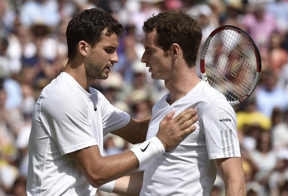 Photo - Grigor Dimitrov of Bulgaria, left, is congratulated by defending champion Andy Murray of Britain after winning their men's singles quarterfinal match at the All England Lawn Tennis Championships in Wimbledon, London, Wednesday July 2, 2014. (AP Photo/Toby Melville, Pool)