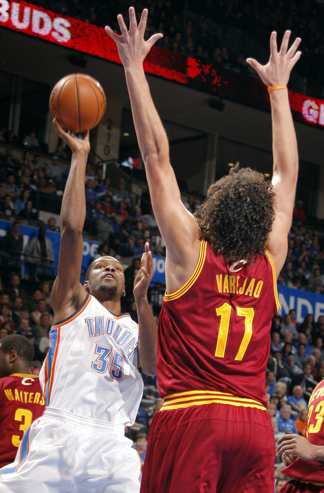 Oklahoma City's Kevin Durant (35) shoots over Cleveland's Anderson Varejao (17) during the NBA basketball game between the Oklahoma City Thunder and the Cleveland Cavaliers at the Chesapeake Energy Arena, Sunday, Nov. 11, 2012. Photo by Sarah Phipps, The Oklahoman