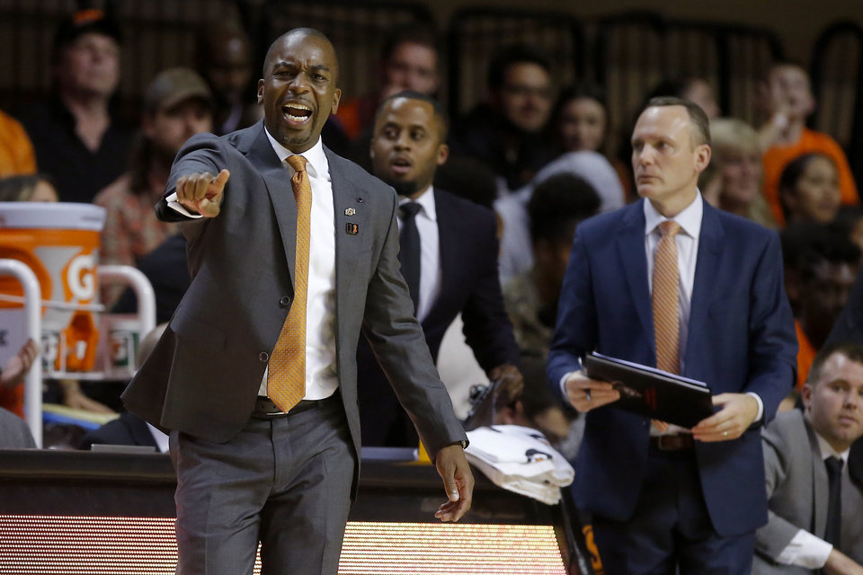 Photo - Oklahoma State coach Mike Boynton shouts during an NCAA basketball game between the Oklahoma State University Cowboys (OSU) and the Oral Roberts Golden Eagles (ORU) at Gallagher-Iba Arena in Stillwater, Okla., Wednesday, Nov. 6, 2019. Oklahoma State won 80-75. [Bryan Terry/The Oklahoman]