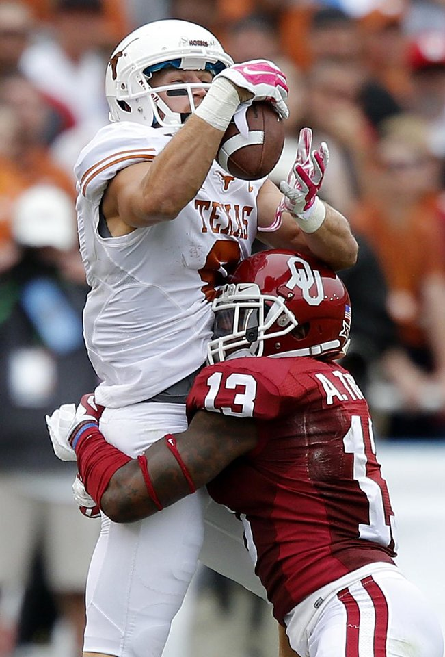 Photo - Texas' Jaxon Shipley (8) makes a catch over Oklahoma's Ahmad Thomas (13) during the college football game between the University of Oklahoma Sooners (OU) and the University of Texas Longhorns (UT) during the Red River Showdown at the Cotton bowl in Dallas, Texas on Saturday, Oct. 11, 2014. Photo by Chris Landsberger, The Oklahoman