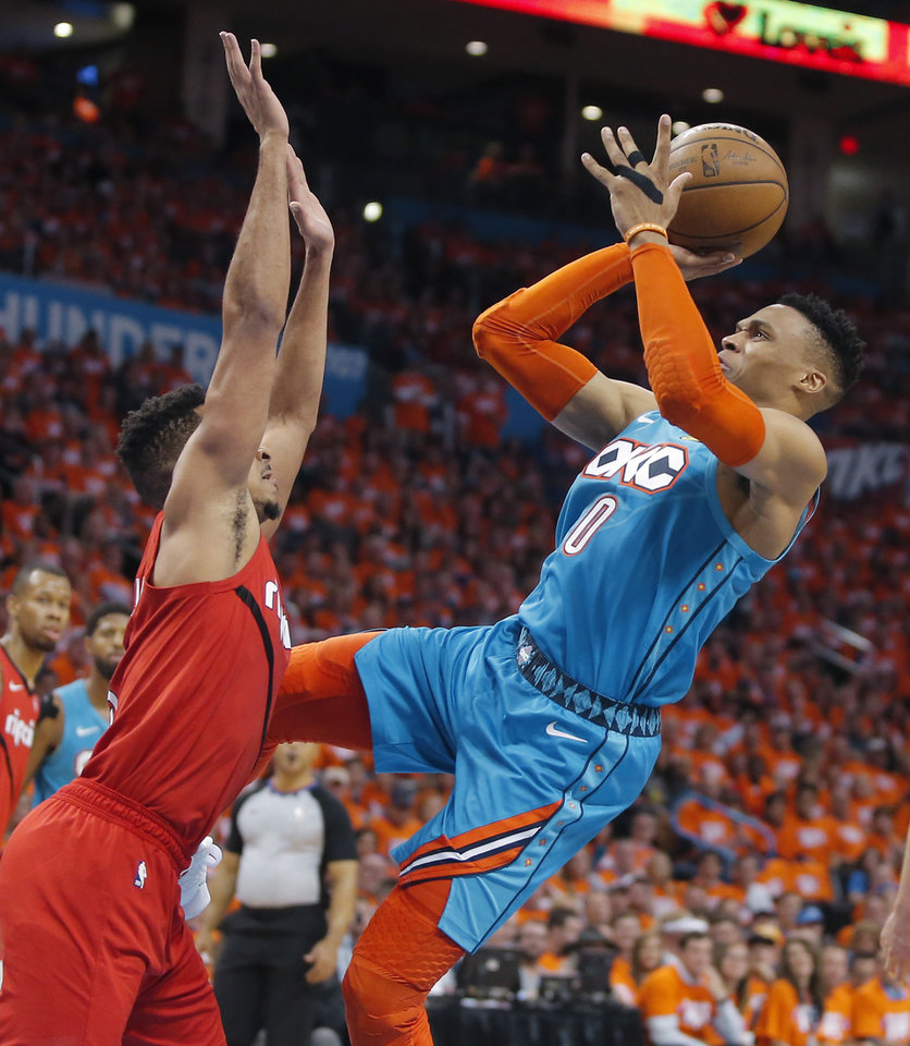 Photo - Oklahoma City's Russell Westbrook (0) is fouled by Portland's CJ McCollum (3) during Game 3 in the first round of the NBA playoffs between the Portland Trail Blazers and the Oklahoma City Thunder at Chesapeake Energy Arena in Oklahoma City, Friday, April 19, 2019. Oklahoma City won 120-108. Photo by Bryan Terry, The Oklahoman