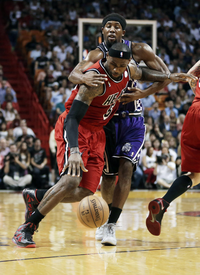 Sacramento Kings' John Salmons (5) fouls Miami Heat's LeBron James (6) during the first half of an NBA basketball game in Miami, Tuesday, Feb. 26, 2013. (AP Photo/J Pat Carter)