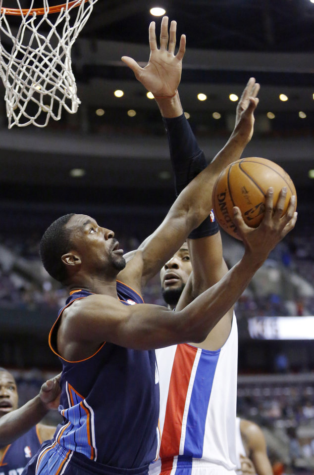 Photo - Charlotte Bobcats guard Ben Gordon, left, gets a shot off against Detroit Pistons forward Andre Drummond in the first half of an NBA basketball game, Sunday, Jan. 6, 2013, in Auburn Hills, Mich. (AP Photo/Duane Burleson)
