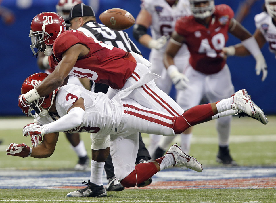 Photo - Alabama's Jarrick Williams (20) commits pass interference on Oklahoma's Sterling Shepard (3) during the NCAA football BCS Sugar Bowl game between the University of Oklahoma Sooners (OU) and the University of Alabama Crimson Tide (UA) at the Superdome in New Orleans, La., Thursday, Jan. 2, 2014.  .Photo by Chris Landsberger, The Oklahoman
