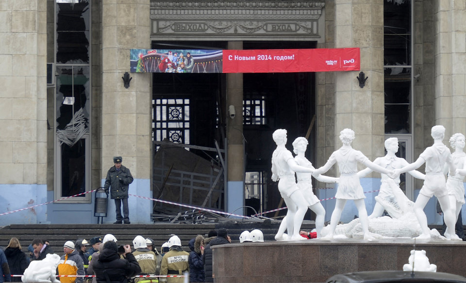 Photo - A police officer guards a main entrance to the Volgograd railway station hit by an explosion, in Volgograd, Russia,  Sunday, Dec. 29, 2013. More then a dozen people were killed and scores were wounded Sunday by a female suicide bomber at a railway station in southern Russia, officials said, heightening concern about terrorism ahead of February's Olympics in the Black Sea resort of Sochi. (AP Photo)
