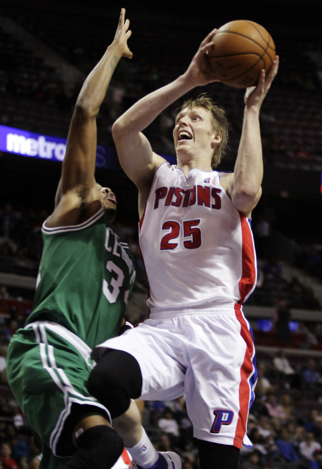 Photo -   Detroit Pistons forward Kyle Singler (25) goes to the basket against Boston Celtics forward Paul Pierce (34) in the second half of an NBA basketball game, Sunday, Nov. 18, 2012, in Auburn Hills, Mich. Singler scored 14 points in a 103-83 win. (AP Photo/Duane Burleson)