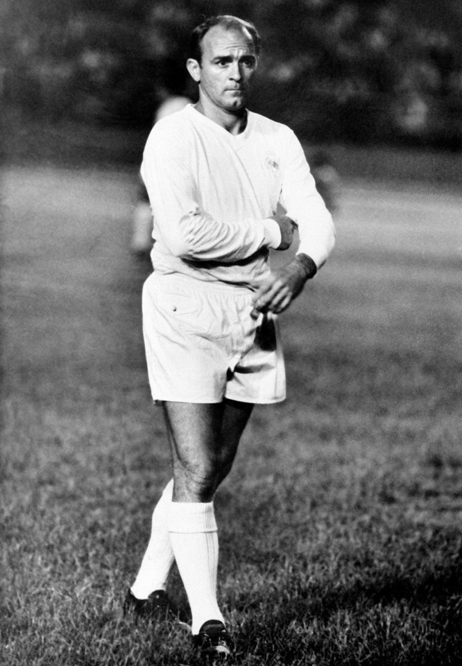 Photo - FILE - In this Aug. 25, 1963 file photo, Alfredo Di Stefano walks on the pitch at the end of the Little World Cup Series first soccer match, in which Real Madrid defeated Oporto 2 -1,  Caracas, Venezuela. Di Stefano, whose goals placed him alongside the all-time great players and propelled Real Madrid to five straight European Champions Cups, has died on Monday, July 7, 2014. He was 88. (AP Photo, File)