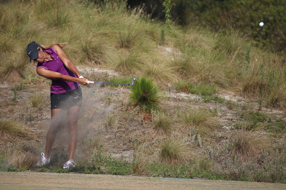 Photo - Cheyenne Woods hits from a waste area on the second hole during the first round of the U.S. Women's Open golf tournament in Pinehurst, N.C., Thursday, June 19, 2014. (AP Photo/John Bazemore)