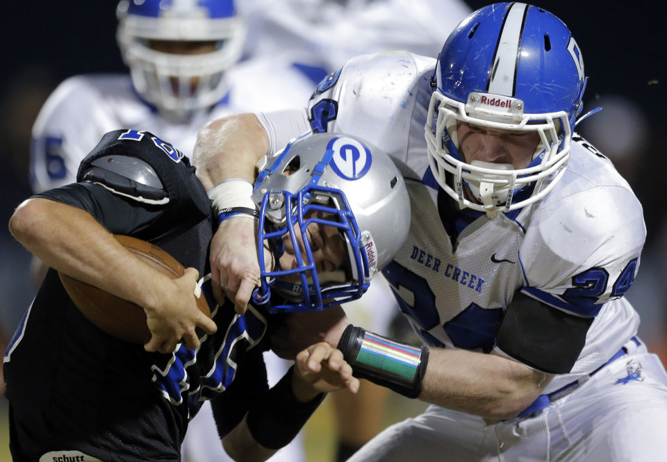 Photo - Deer Creek's Kooper Ruminer tackles Guthrie's Bryan Dutton during the high school football game between Guthrie and Deer Creek at Guthrie, Thursday, Oct. 18, 2012. Photo by Sarah Phipps, The Oklahoman