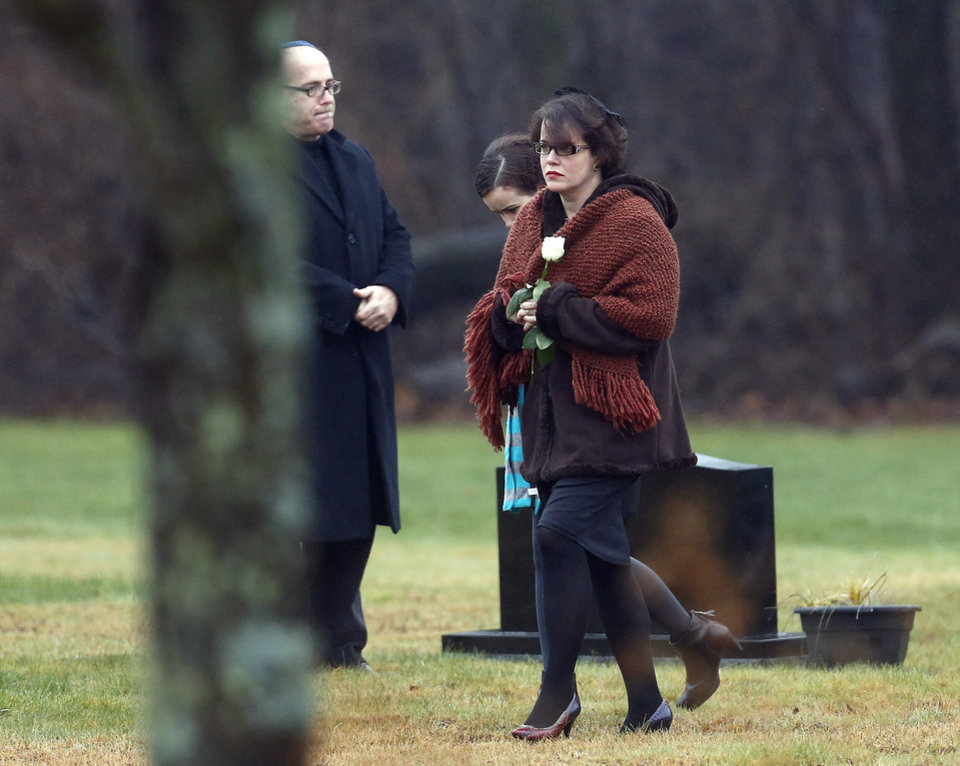 Photo - Veronique Pozner arrives at B'nai Israel Cemetery, Monday, Dec. 17, 2012, in Monroe, Conn., for burial services for her 6-year-old son Noah Pozner, who was killed Friday when Adam Lanza opened fire inside the Sandy Hook Elementary School in Newtown, killing 26 people, including 20 children, before taking his own life. (AP Photo/Julio Cortez) ORG XMIT: CTJC118