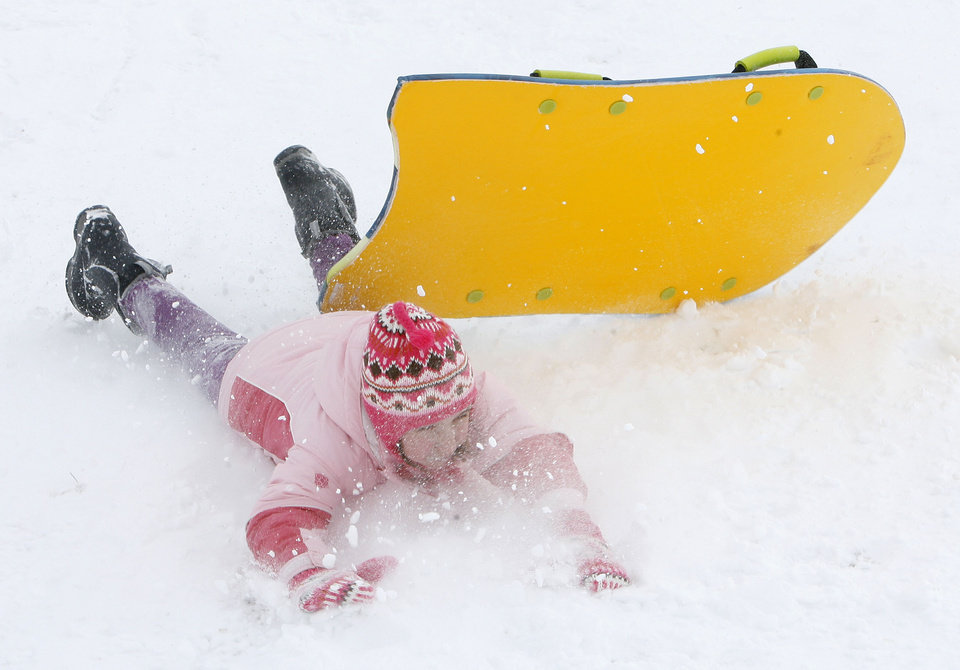 Nine-year-old Kathryn Baroli parts ways with her sled after hitting a large bump at Will Rogers Park in Oklahoma City., Saturday, Jan. 30, 2010. By Paul Hellstern, The Oklahoman