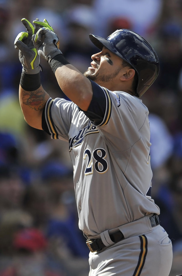 Photo - Milwaukee Brewers' Gerardo Parraolo points skyward at home plate after hitting a solo home run during the seventh inning of a baseball game against the Chicago Cubs in Chicago, Monday, Sept. 1, 2014. Chicago won 4-2. (AP Photo/Paul Beaty)