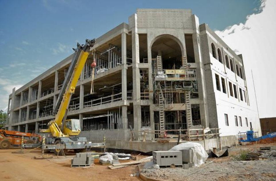 Photo -  Construction of the outside of Edmond's public safety center is seen on Sept. 16, 2014. The new three-story building changed the landscape of downtown. [PHOTO BY CHRIS LANDSBERGER, THE OKLAHOMAN ARCHIVES]