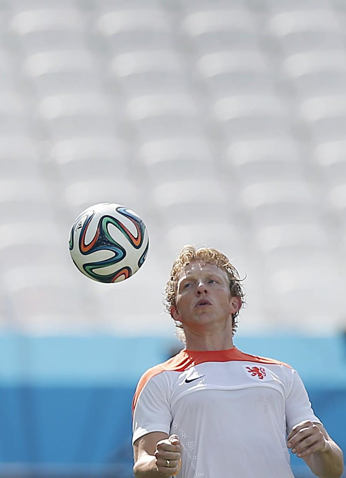 Photo - Dirk Kuyt of the Netherlands is seen during a training session at the Itaquerao Stadium in Sao Paulo, Brazil, Sunday, June 22, 2014.  The Netherlands will play Chile in a match that will decide the winner of Group B at the 2014 soccer World Cup. (AP Photo/Wong Maye-E)