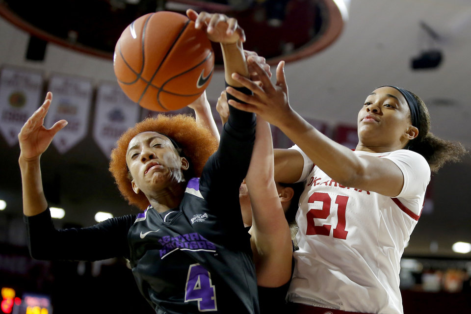 Photo - Oklahoma's Nydia Lampkin (21) reaches for the ball beside Central Arkansas' Taylor Sells (4) during an NCAA women's basketball game between the University of Oklahoma (OU) and Central Arkansas at Loyd Noble Center in Norman, Okla., Wednesday, Dec. 5, 2018. Photo by Bryan Terry, The Oklahoman