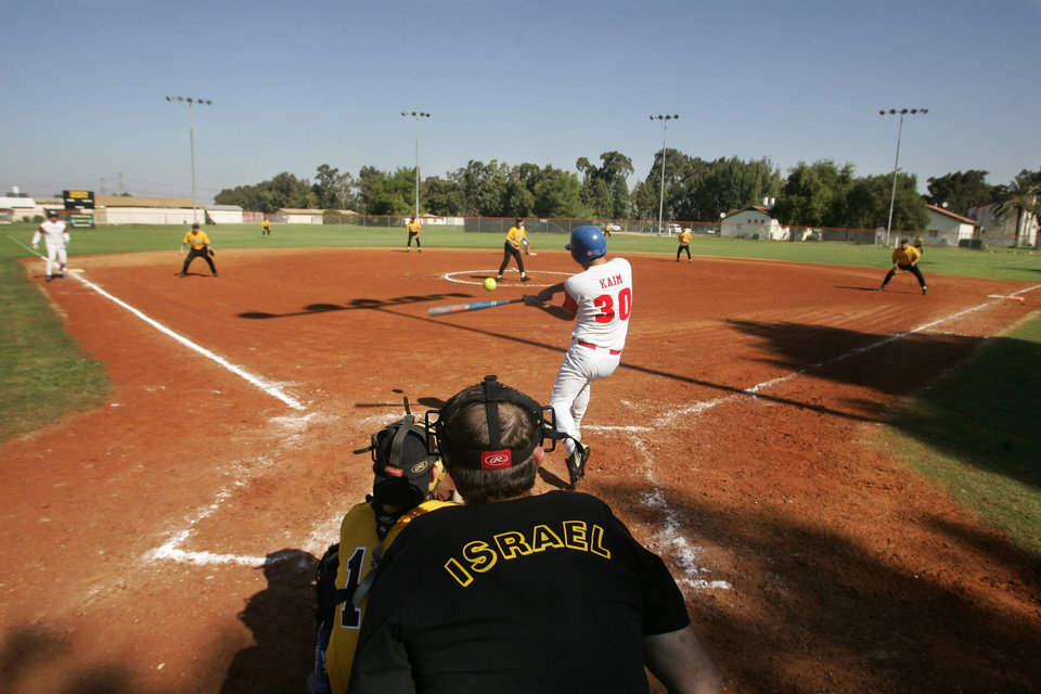 Photo -   FILE - In this Nov. 10, 2006, file photo, baseball players compete in tryouts in Petah Tikva, Israel. With a pair of Jewish ex-major leaguers on his roster, Israel's coach for next year's World Baseball Classic team, Brad Ausmus, said Monday, May 21, 2012, that his squad is already a legitimate contender. (AP Photo/Baz Ratner, File)