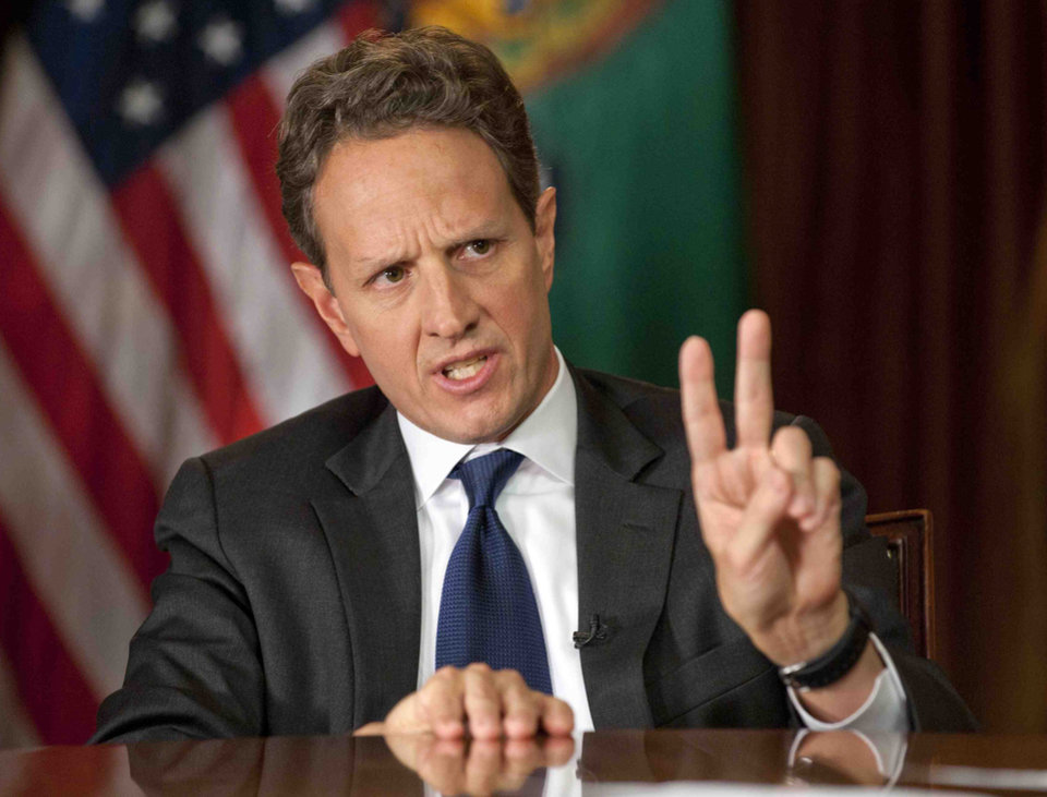 In this Nov. 30, 2012, photo provided by CBS News Treasury Secretary Timothy Geithner answers questions about averting the
