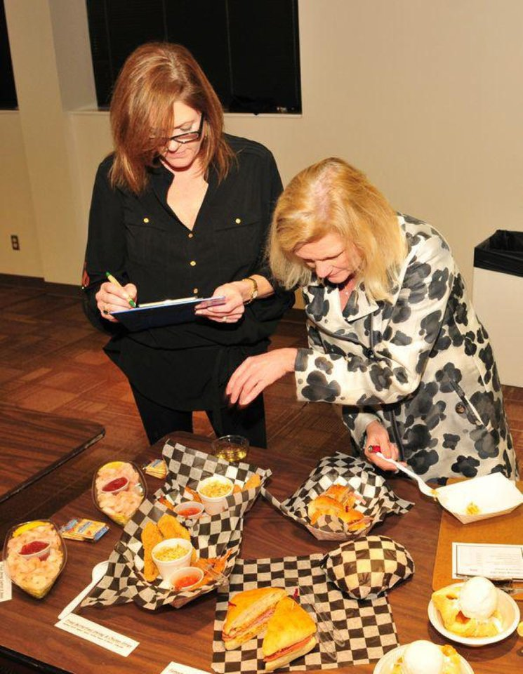Arts Council of Oklahoma City Food Committee Members Teresa Portwood and Meg Salyer sample foods vying for a spot in Aprils Festival of teh Arts. <strong> - PROVIDED</strong>