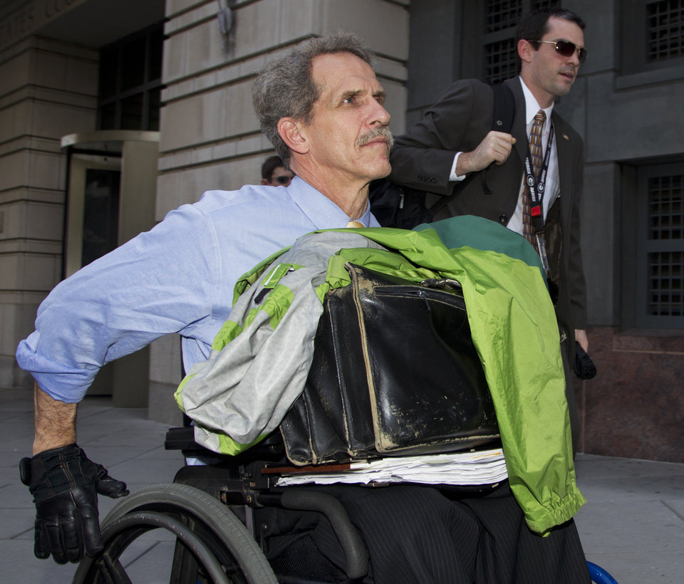 Photo -   Daniel Butler, the prosecutor for the perjury trial of former Major League Baseball pitcher Roger Clemens, front, leaves federal court in Washington, Friday, May 25, 2012. A forensic scientist testified Friday that two cotton balls and a syringe needle allegedly saved after a steroids injection, tested positive for Roger Clemens' DNA, a key moment as the government tries to prove the former pitcher used performance-enhancing drugs. (AP Photo/Manuel Balce Ceneta)