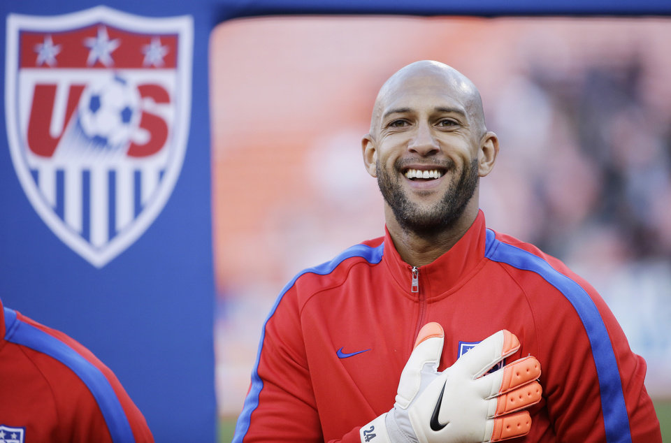 Photo - United States goalkeeper Tim Howard smiles during player introductions before an international friendly soccer match against Azerbaijan on Tuesday, May 27, 2014, in San Francisco. (AP Photo/Marcio Jose Sanchez)