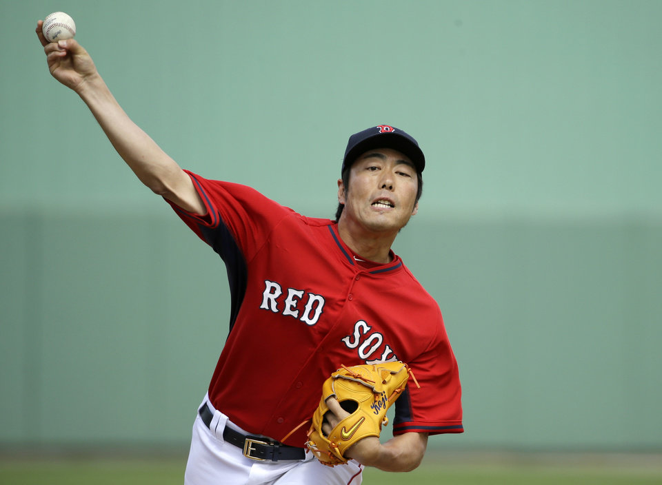 Photo - Boston Red Sox's Koji Uehara, of Japan, delivers a warm-up pitch in the fifth inning of an exhibition baseball game against the Atlanta Braves, Friday, March 7, 2014, in Fort, Myers, Fla. The Red Sox won 4-1 over the Braves. (AP Photo/Steven Senne)