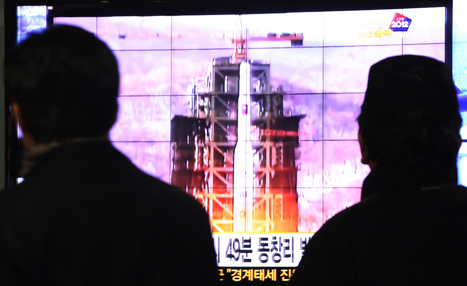 South Koreans watch a TV news reporting launch of the Unha rocket from Tongchang-ri, North Korea, at Seoul Railway Station in Seoul, South Korea, Wednesday, Dec. 12, 2012. North Korea fired a long-range rocket Wednesday in its second launch under its new leader, South Korean officials said, defying warnings from the U.N. and Washington only days before South Korean presidential elections. (AP Photo/Ahn Young-joon) ORG XMIT: SEL113
