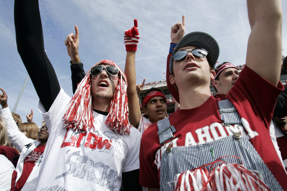 Photo - Jordan Egli and Evan Maynard, both Broken Arrow freshmen, cheer at the college football game between The University of Oklahoma Sooners (OU) and the Baylor Bears at the Gaylord Family-Oklahoma Memeorial Stadium on Saturday, Oct. 10, 2009, in Norman, Okla.