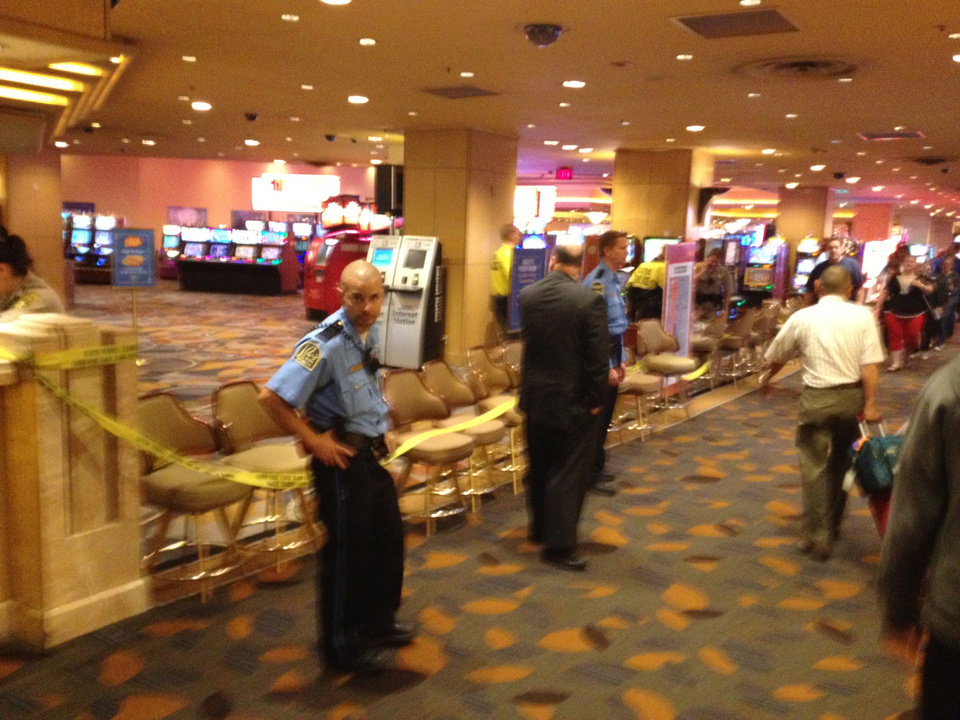 Photo - A hotel security officer is shown in Bally's hotel-casino after an argument over a cover charge led to a nightclub shooting early Monday, Oct. 21, 2013,  on the Las Vegas Strip that left one patron dead when he tried to subdue the gunman and two employees wounded, police said.  A suspect is in custody, police said. (AP Photo/Las Vegas Sun/Brian Nordli)   LAS VEGAS REVIEW-JOURNAL OUT