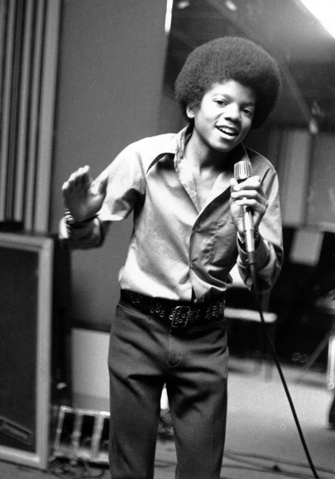 FILE - In this 1972 file photo, singer Michael Jackson at age 13, the youngest member of the singing group Jackson Five, sings in his home in Encino, Ca. (AP Photo, file) ORG XMIT: NYET701