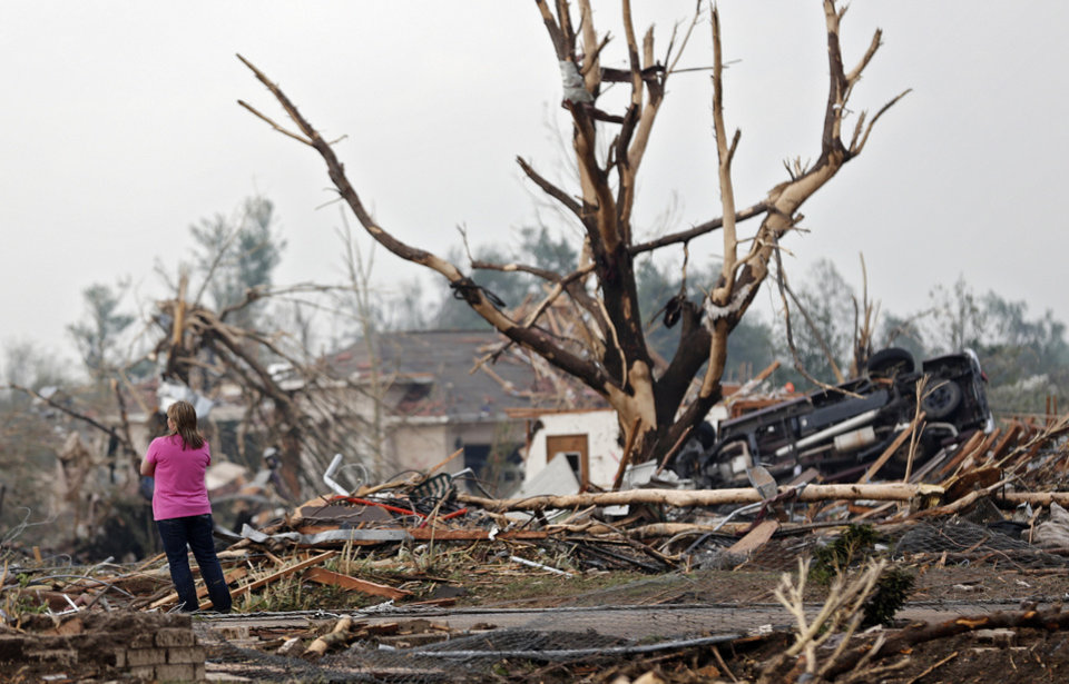 A resident surveys the damage after the tornado hit the area near 149th and Drexel on Monday, May 20, 2013 in Oklahoma City, Okla.  Photo by Chris Landsberger, The Oklahoman