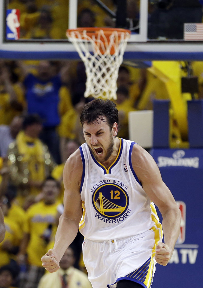Photo - Golden State Warriors' Andrew Bogut reacts after scoring against the Denver Nuggets during the first half of Game 4 in a first-round NBA basketball playoff series, Sunday, April 28, 2013, in Oakland, Calif. (AP Photo/Ben Margot)