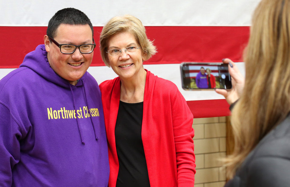 "Photo - Jose Gallegos, a senior at NWC, poses for a ""selfie"" with Sen. Elizabeth Warren after a rally  in Oklahoma City at Northwest Classen High School, her alma mater, Sunday, December 22, 2019. [Photo by Doug Hoke/The Oklahoman]"