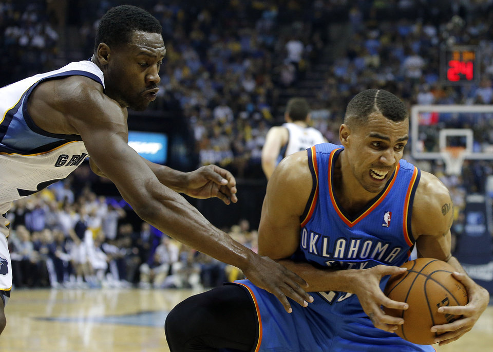Photo - Oklahoma City's Thabo Sefolosha (25) grabs the ball in front of Memphis' Tony Allen (9) during Game 3 in the first round of the NBA playoffs between the Oklahoma City Thunder and the Memphis Grizzlies at FedExForum in Memphis, Tenn., Thursday, April 24, 2014. Memphis won 98-95. Photo by Bryan Terry, The Oklahoman