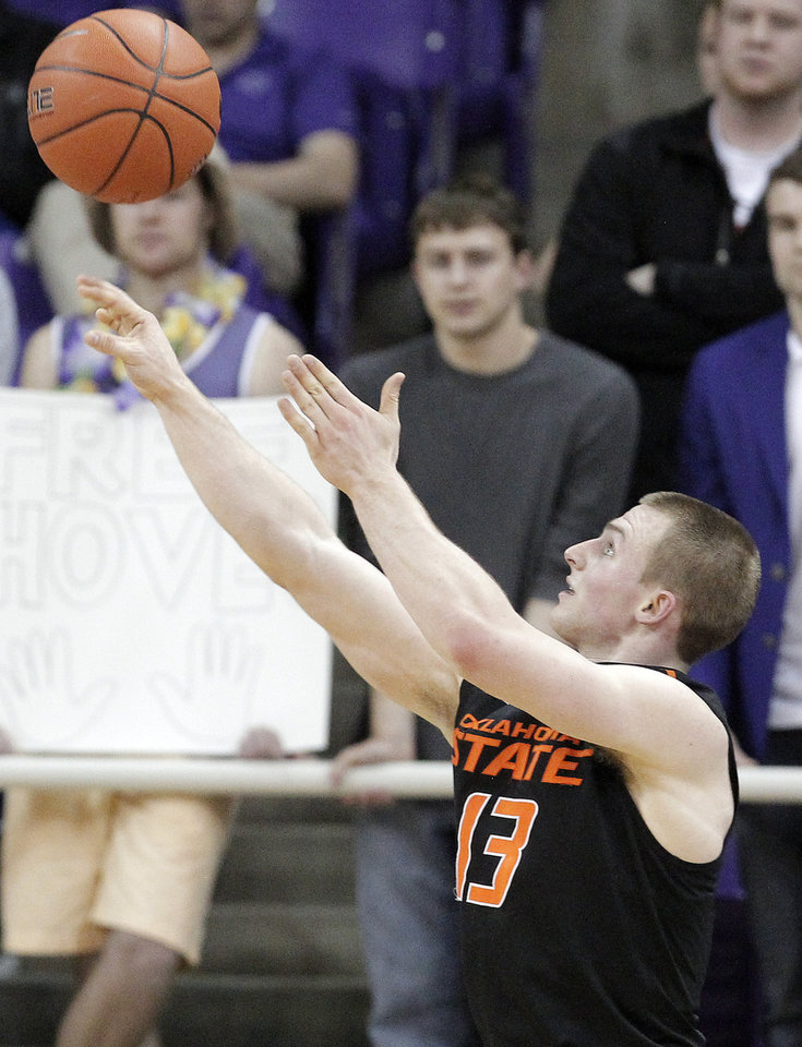 Photo - Oklahoma State guard Phil Forte III (13) attempts a shot in the second half of an NCAA college basketball game against TCU, Monday, Feb. 24, 2014, in Fort Worth, Texas. Oklahoma State won 76-54. (AP Photo/Brandon Wade)