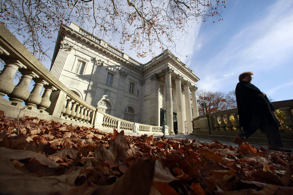 Photo - FILE - In this Nov. 19, 2010 file photo, a woman walks past the front entrance to Marble House mansion, in Newport, R.I.  A new tourism effort, in May 2013, highlights areas in the southern New England states of Connecticut, Massachusetts and Rhode Island. (AP Photo/Steven Senne, File)