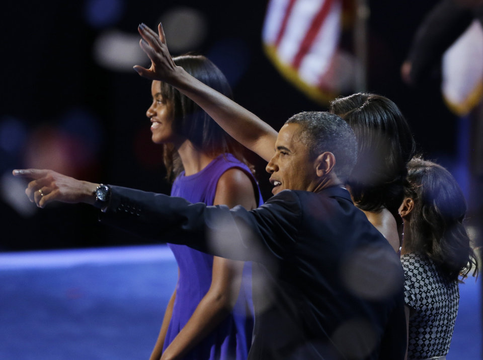 Photo -   President Barack Obama waves with his wife Michelle and his daughters Malia and Sasha after his speech to the Democratic National Convention in Charlotte, N.C., on Thursday, Sept. 6, 2012. (AP Photo/Lynne Sladky)