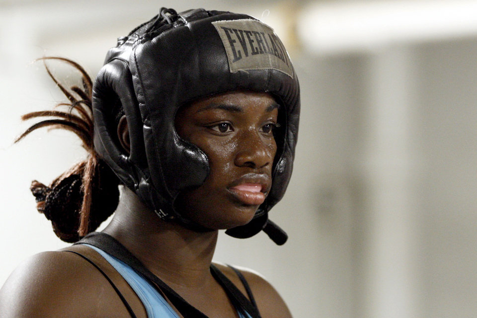 Photo -   In this Sept. 18, 2012, photo, Olympic gold medal boxer Claressa Shields trains at the Berston Field House in Flint, Mich. Aside from her Olympic title and a jab that could knock someone out cold, Shields isn't much different than other high school seniors. (AP Photo/Carlos Osorio)