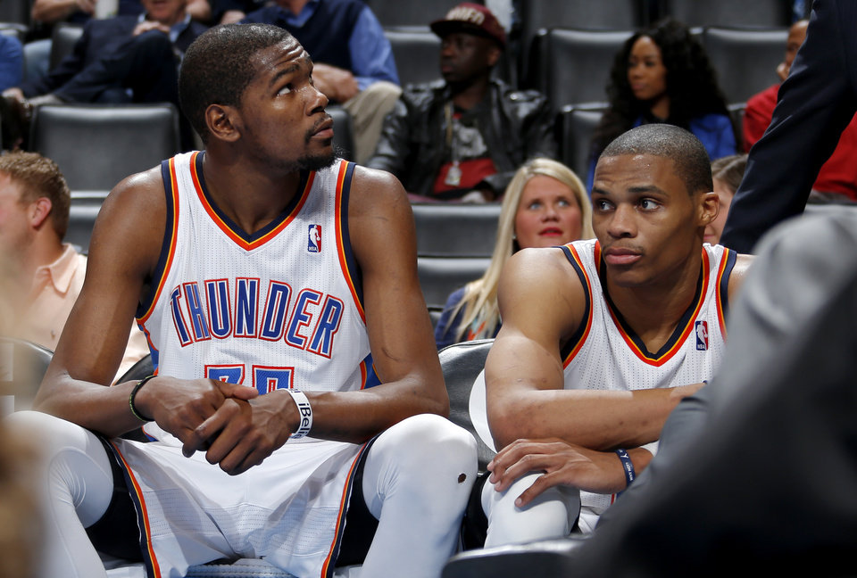 Oklahoma City\'s Kevin Durant (35) and Russell Westbrook (0) sit on the bench in the final seconds of an NBA basketball game between the Oklahoma City Thunder and the Denver Nuggets at Chesapeake Energy Arena in Oklahoma City, Tuesday, March 19, 2013. Denver won 114-104. Photo by Bryan Terry, The Oklahoman