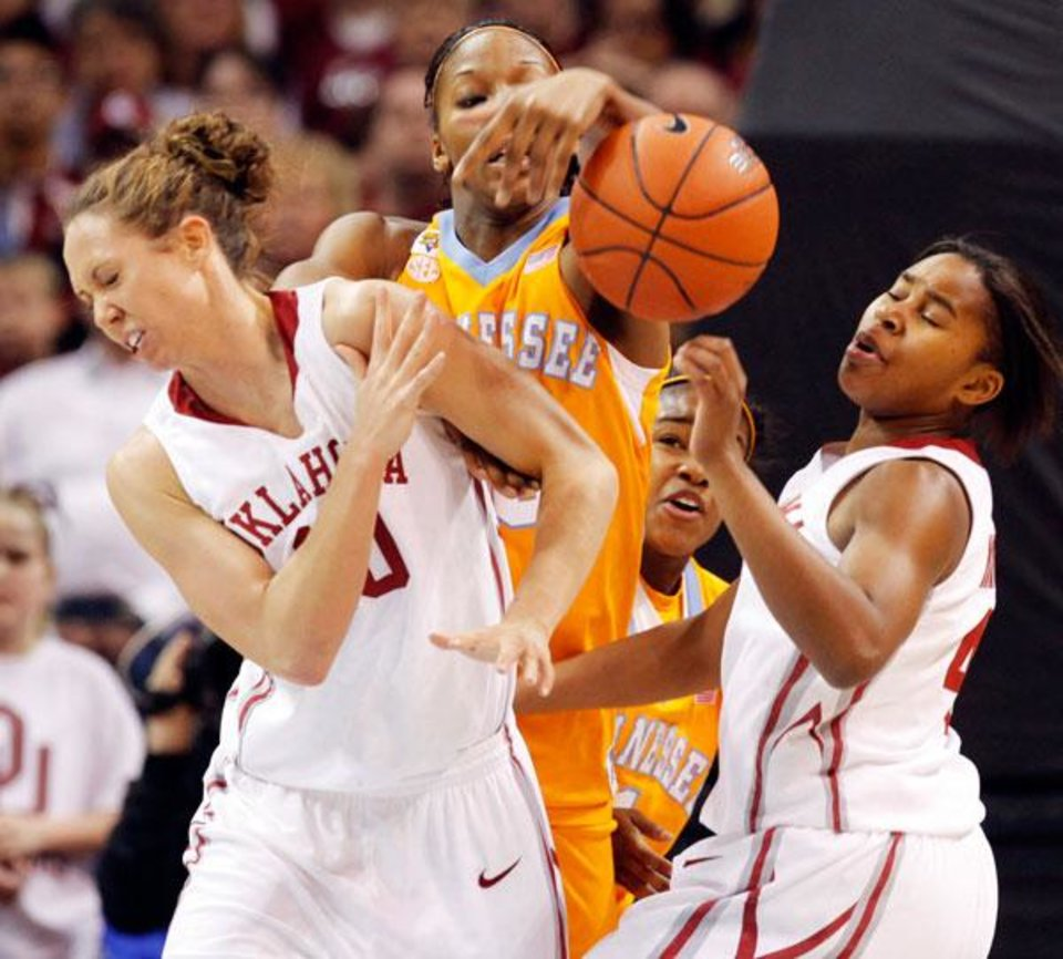 Photo -  Tennessee's Glory Johnson (25), middle, steals the ball from OU's Jasmine Hartman (45), right, next to Carlee Roethlisberger (10), left, as Tennessee's Briana Bass (1) looks on in the background in the first half of the women's college basketball game between Oklahoma and Tennessee at the Ford Center in Oklahoma City, Monday, February 2, 2009. BY NATE BILLINGS, THE OKLAHOMAN
